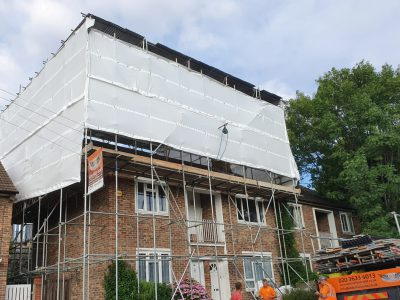 picture of a scaffolding and temporary roof erected on residential building