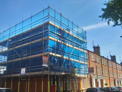 picture of a scaffolding with blue mesh sheeting cover erected by atd